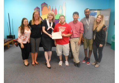 Community Foundation of Mississauga Executive Director Eileen MacKenzie with NYS staff and youth